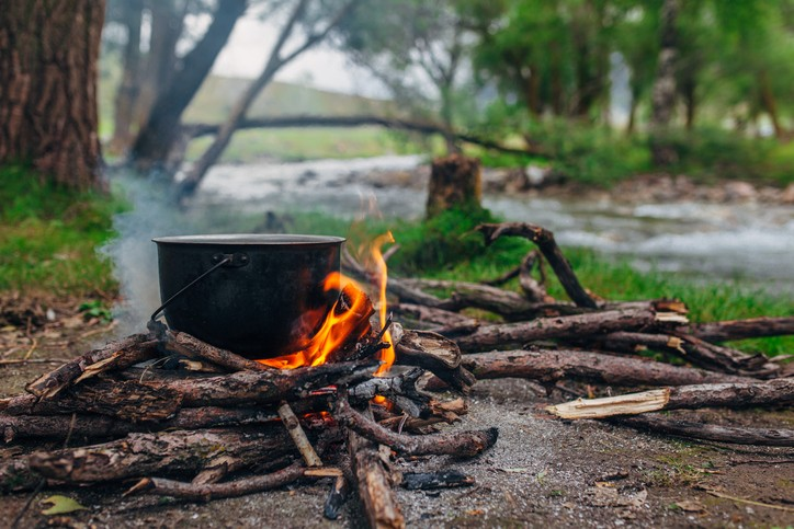 A fire and making coffee in a clearing near the river.