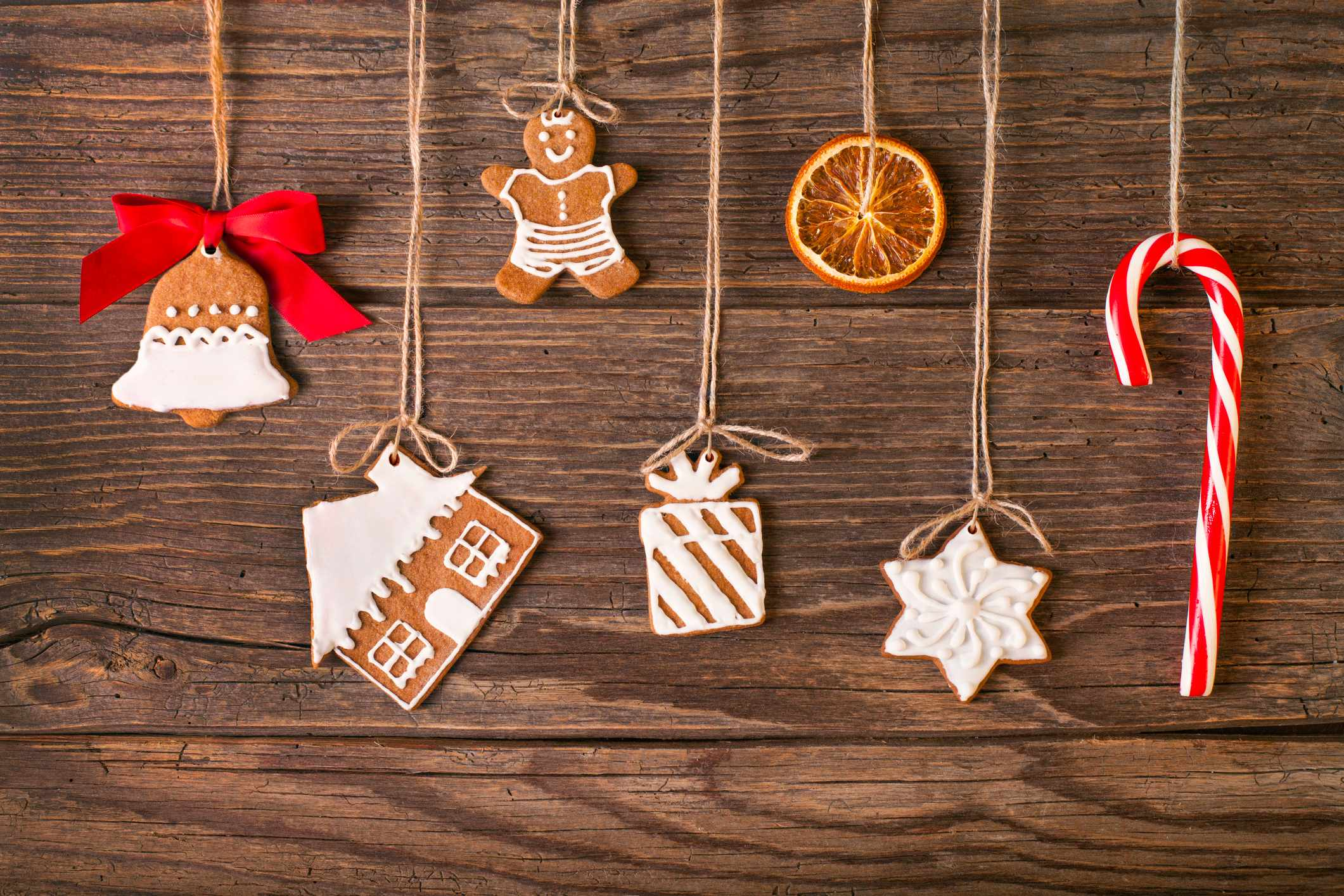 Christmas gingerbread cookies on wood background. Used gingerbread cookies home-handedly made it from me. They are unique pieces and can not be found anywhere.