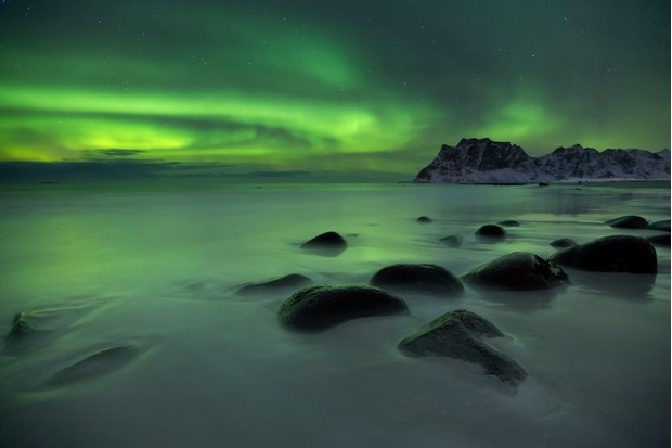The aurora borealis over Uttakleiv beach on the Lofoten in northern Norway in winter.
