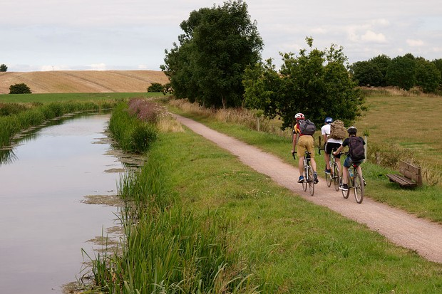Teens cycling along the towpath of the Bridgewater and Taunton Canal, Taunton, Somerset, UK. (Photo by: Education Images/UIG via Getty Images)