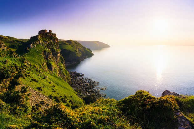 Valley of the Rocks and Wringcliff Bay at sunset in Exmoor National Park, Lynton, England. (Photo by: Loop Images/UIG via Getty Images)
