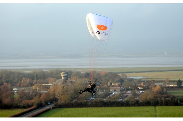 GLOUCESTERSHIRE, UNITED KINGDOM - DECEMBER 16: Human Swan Sacha Dench pictured passing WWT Slimbridge during the final leg of her 'Flight of the Swans' using a motorised paramotor from northern Russia to WWT Slimbridge on December 16, 2016 in Gloucestershire, England.  The flight aimed to map remote areas of the Bewick swans path to understand what has been killing them off.  PHOTOGRAPH BY Paul Nicholls / Barcroft Images  London-T:+44 207 033 1031 E:hello@barcroftmedia.com - New York-T:+1 212 796 2458 E:hello@barcroftusa.com - New Delhi-T:+91 11 4053 2429 E:hello@barcroftindia.com www.barcroftimages.com (Photo credit should read Paul Nicholls / Barcroft Images / Barcroft Media via Getty Images)