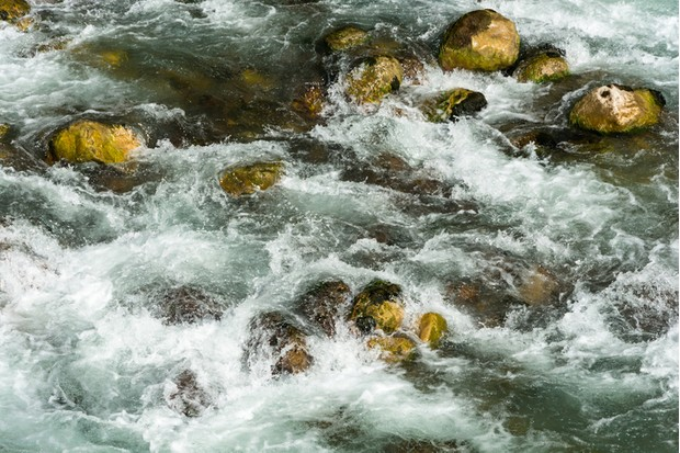 Rapid turbulent stream of water and stones.