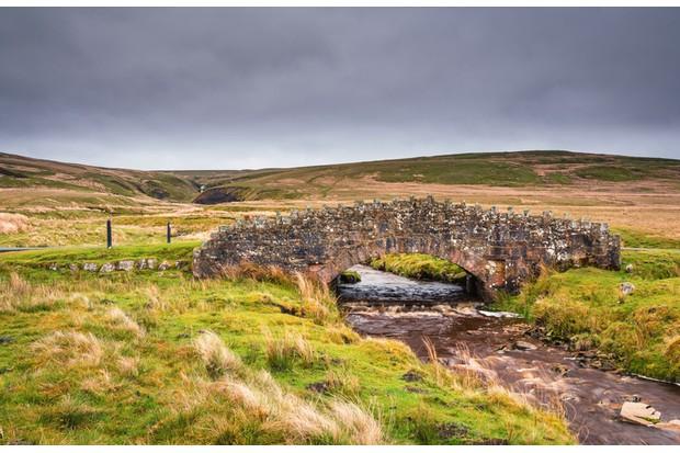 Stonesdale Beck flows below Stonesdale Bridge on Stonesdale Moor in Upper Swaledale, part of Yorkshire Dales National Park