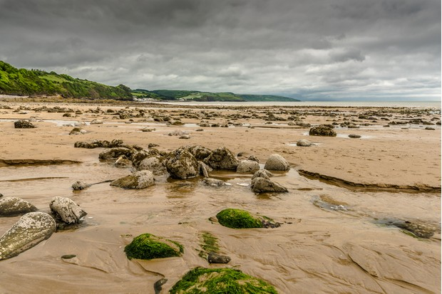 At low tide, Saundersfoot Beach lays strewn with boulders