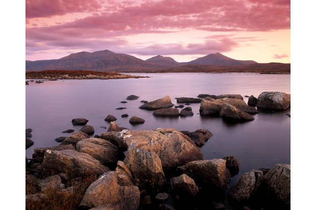 Loch Druidibeg Nature Reserve at sunset, with Hecla, Ben Corodale and Beinn Mhor behind, South Uist, Outer Hebrides, Scotland, United Kingdom, Europe