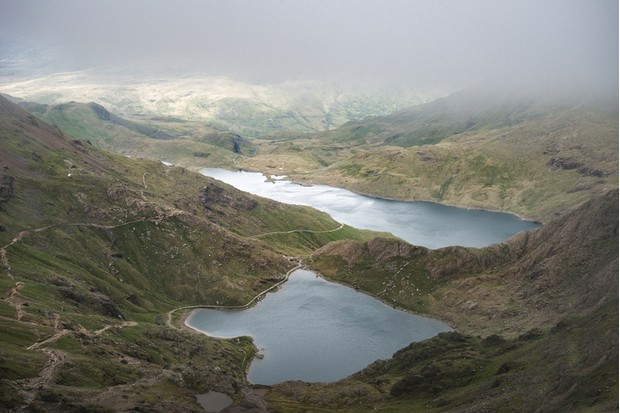 Landscape image of Glaslyn and Llyn Llydaw in Snowdonia with Glyder Fawr in the background with low cloud cover
