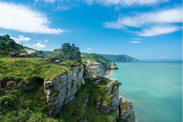 Hiker on the headland in Valley of the Rocks on South West coast path near Lynmouth