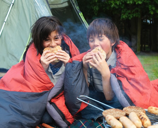 Young boy and girl camping