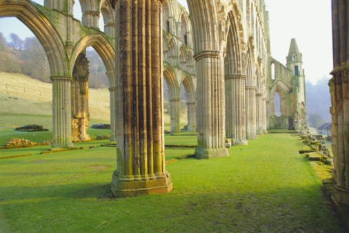 Beneath the pillars at Rievaulx Abbey