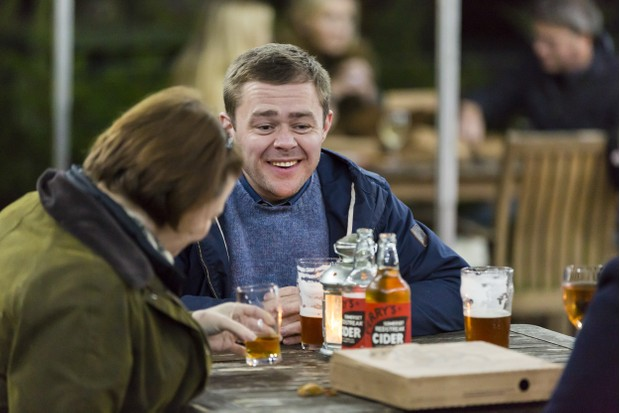 Visitors enjoying a drink in the pub beer garden at Gibside, Tyne & Wear. Gibside Pub and Beer Garden is one of only two National Trust pubs in the country.