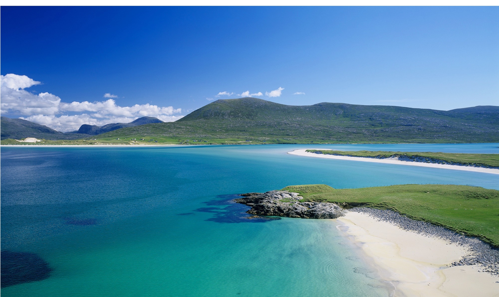 View of Harris Island on The Sound of Taransay, Western Isles, Scotland. The Outer Hebrides comprise of an chain of 30 islands off the west coast of Scotland. With visually stunning white beaches and windswept terrain the Outer Hebrides is one of the most beautiful and untouched places in the world.
