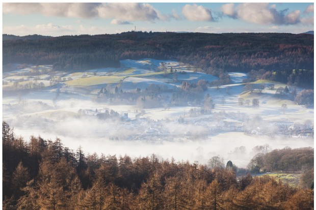 Winter veil: the village of Hawkshead in the Lake District National Park wakes to a blanket of thin frost and low-lying mist
