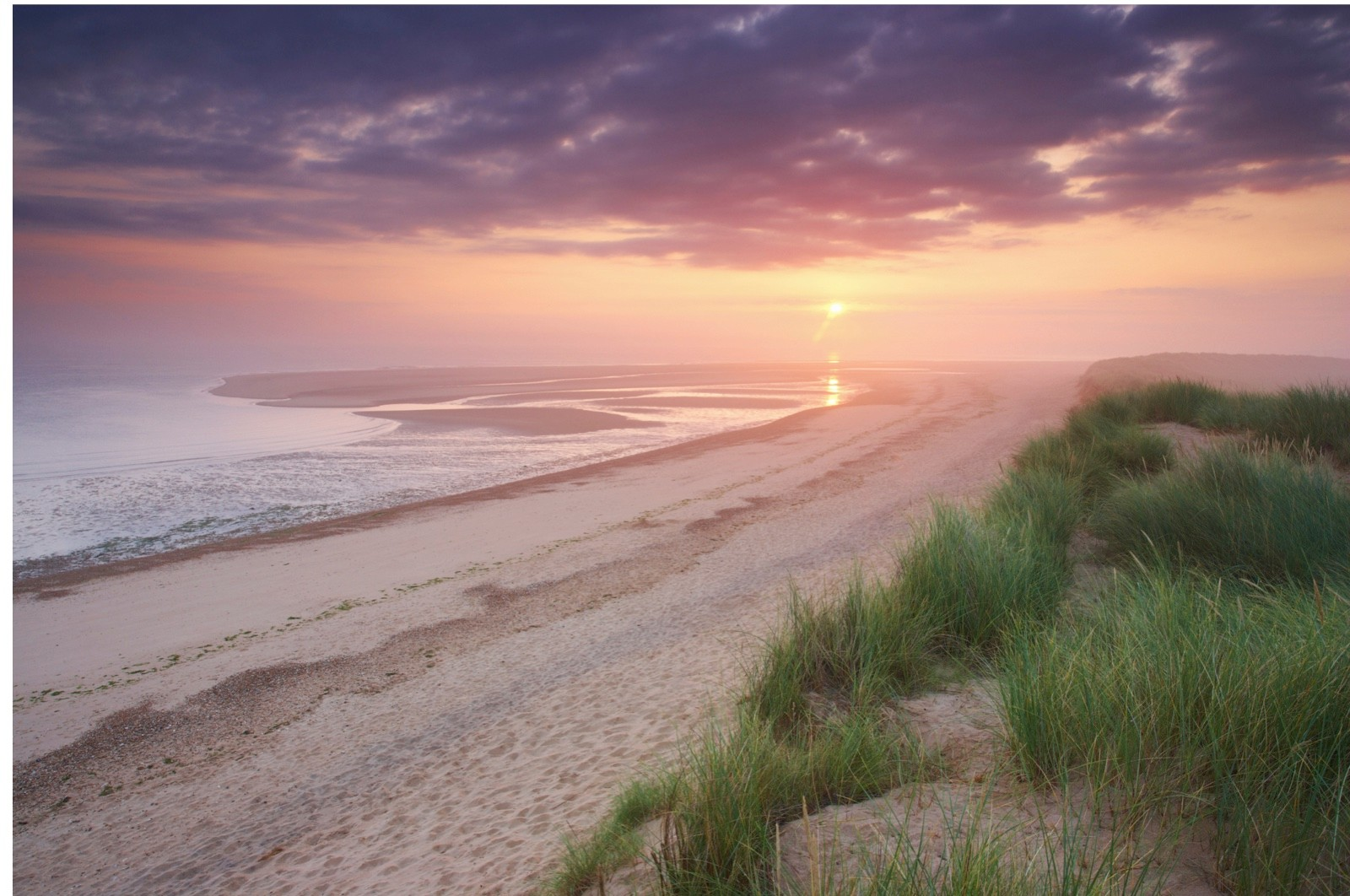 Sunrise on a misty morning at Holkham Bay on the North Norfolk Coast