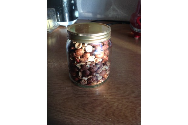 Roasted hazelnuts in a jar