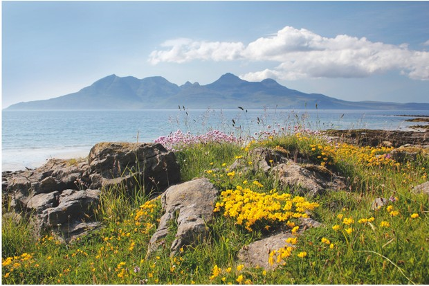 The saw-toothed outline of Rum punctuates the skyline to the north-west of Eigg – both form part of an archipelago known as the Small Isles ©RSPB Images