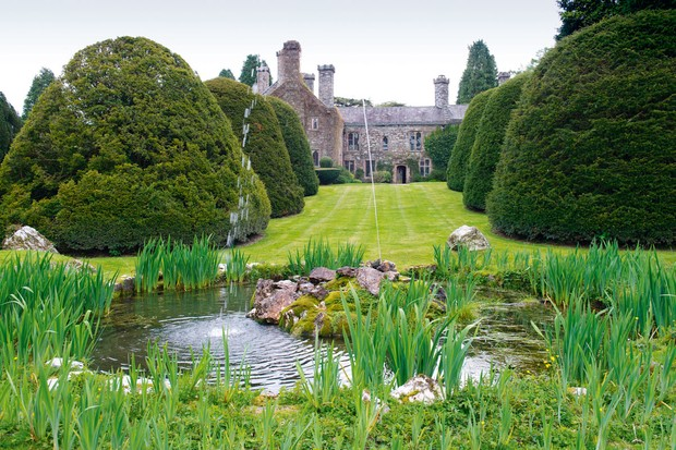 Wonder around the lush grounds of Gwydir Castle in Snowdonia