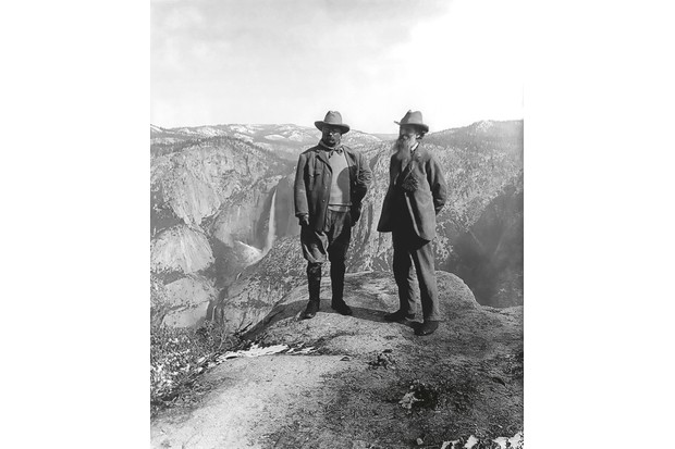 Two men at the top of a mountain