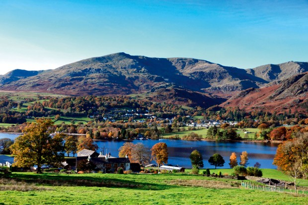 Coniston Water – the third largest waterbody in the Lake District – sits beneath The Old Man's russet-coloured slopes on a sunny day in autumn