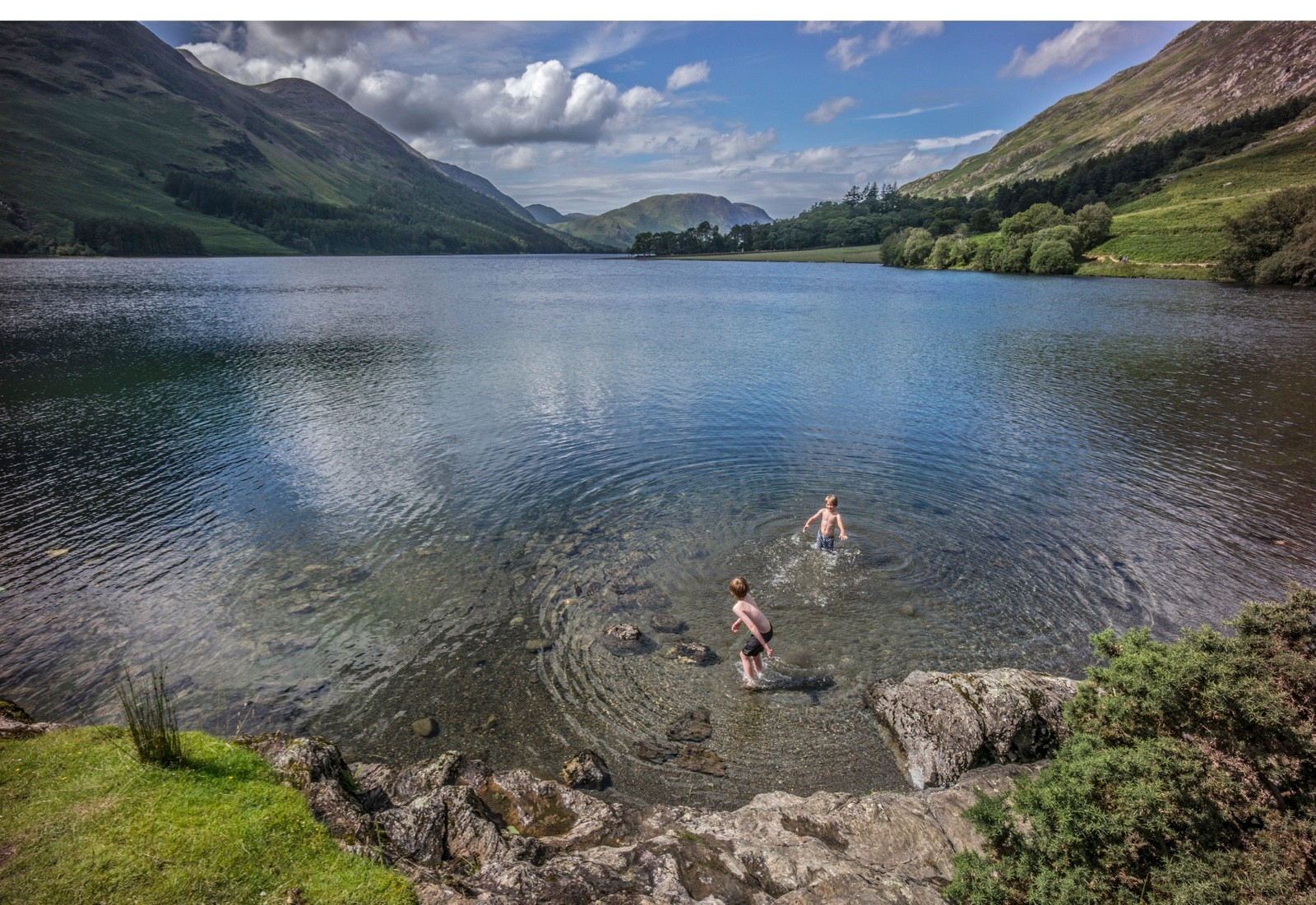 Wild swimming boys in Buttermere the Lake District National Park