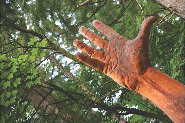 CTR8EP Simon O'Rourke's 'The Giant Hand Of Vyrnwy' statue on July 27, 2012 at Lake Vyrnwy, Wales.