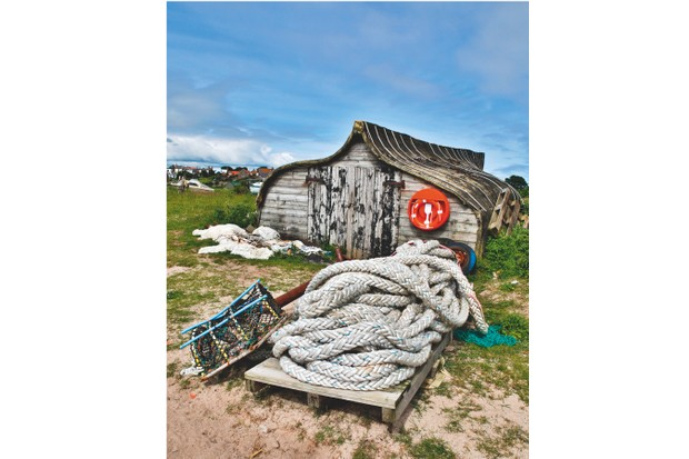 Local fisherman use old, upturned boats as storage huts