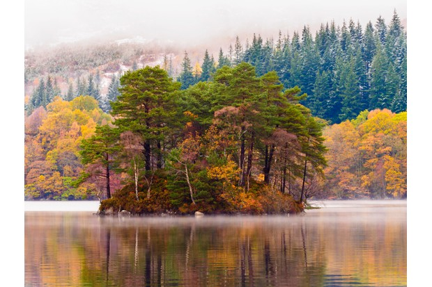 Autumn envelopes Loch Katrine and its wooded islands ©Getty
