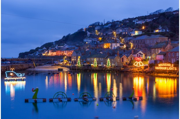 Beautiful display of Christmas Lights at Mousehole Harbour Cornwall England UK Europe