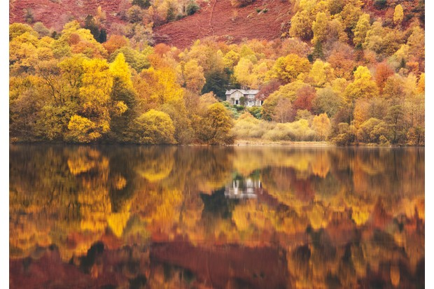 A stroll in the footsteps of the Wordsworth family offers exquisite reflections of autumn colour in the still waters of Rydal Water at Grasmere in the Lake District