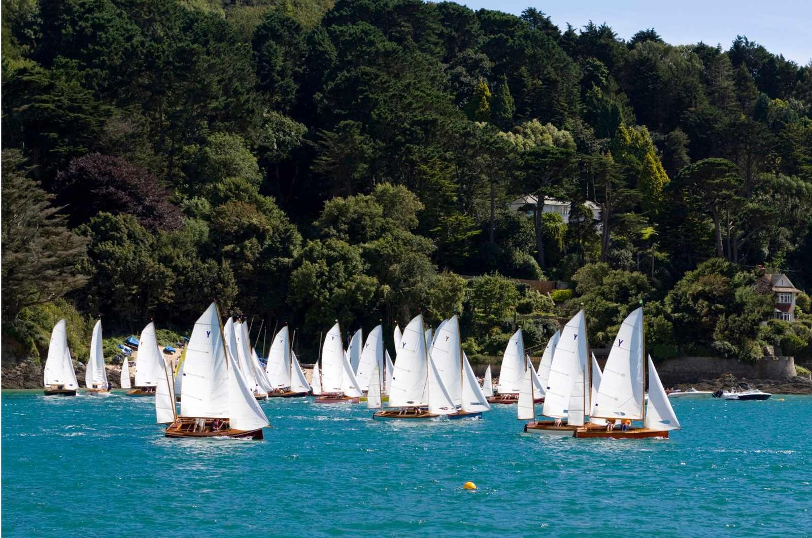 Yawl class sailboats racing in beautiful estuary. Salcombe, Devon, UK.