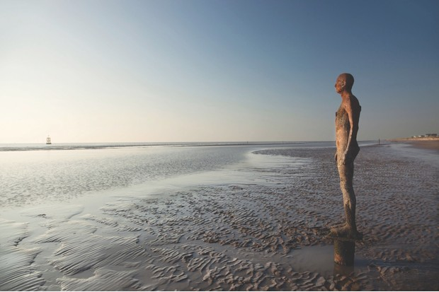 BT34G0 The Sir Antony Gormley art installation Another Place  located on Crosby Beach, part of the Sefton Coast, within the Liverpool City Region of the UK
