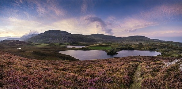 Panorama sunrise landscape over Cregennen Lakes with Cadair Idris in background. (Photo by: Loop Images/UIG via Getty Images)