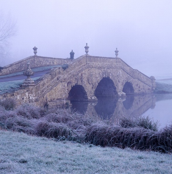 Bridge in mist. Stowe Landscape garden, Buckinghamshire. (Photo by Arcaid/UIG via Getty Images)