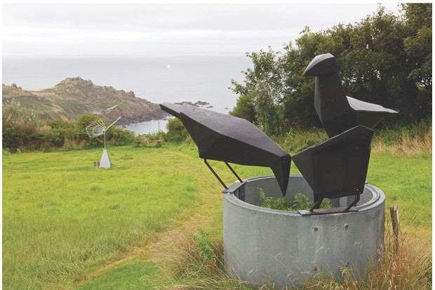 DFHNPR Sculpture 'Three Jackdaws on a Chimney' by Terence Coventry overlooking the Cornish coast at Coverack