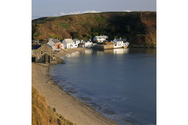 Sheltered fishing hamlet on the Lleyn Peninsula in the early morning sunlight.
