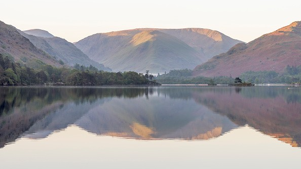 CUMBRIA, UNITED KINGDOM - MAY 15: View of Ullswater lake area on May 15, 2018 in Cumbria, England. The weather has been stunning, the water has been super-calm and the dawns have been slightly misty.   PHOTOGRAPH BY Benjamin Graham / Barcroft Images (Photo credit should read Benjamin Graham / Barcroft Images / Barcroft Media via Getty Images)