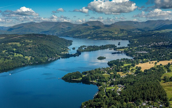 CUMBRIA, UNITED KINGDOM - JULY 12: An aerial view of  the northern end of Lake Windermere, Bowness-on-Windermere and the lake District mountains in the background on July 12, 2017 in Bowness-on-Windermere, in Cumbria, England. (Photograph by David Goddard/Getty Images)