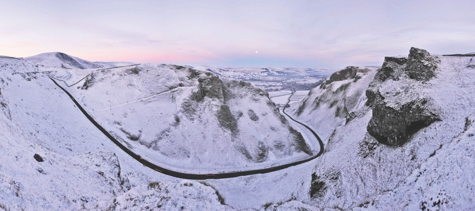 PEAK DISTRICT, UNITED KINGDOM - DECEMBER 20: EXCLUSIVE. Panoramic sunset image made up of six photographs showing Winnats Pass, close to Castleton village in the heart of The Peak District on December 20, 2010 in the Peak District, England. (Photo by Robbie Shone / Barcroft Media / Getty Images)