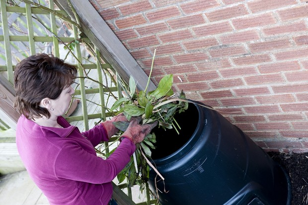 Woman_putting_garden_trimmings_into_compost_bin_-_Web_Version__72ppi-b6e6339