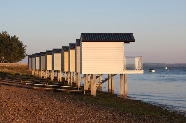 Pastel coloured beach huts at Heybridge, Essex, England