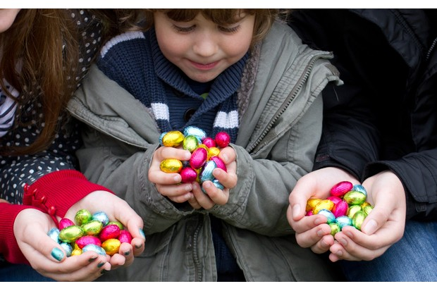 Three siblings compare number of Easter Egg's they found after Easter Egg hunt.