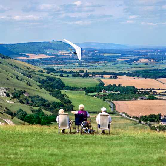 Wheelchair users on hill