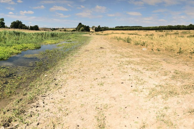 Main image: The near dry River Kennet at West Overton near Marlborough on July 10, 2018 in Wiltshire, England. Hot temperatures across the UK for the past few weeks, combined with increased water usage and a short supply of rain during the recent heatwave, has caused very low water levels in many rivers/Credit: Getty
