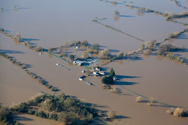 An aerial view of a flooded farm in Gloucestershire