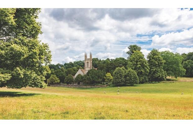 St Nicholas Church nestled amongst the trees on the Chawton House parkland, Hampshire, UK