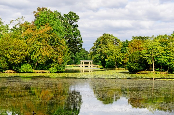 Water gardens at Stowe House and School in the Aylesbury Vale district of Buckinghamshire, England. The Palladian Bridge in the distance.