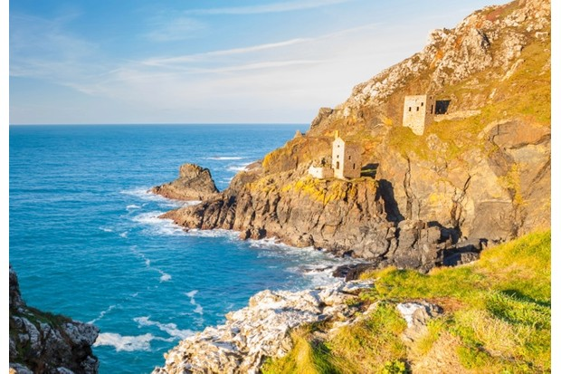The Crown engine houses pearced on the cliffs at Botallack on near St Just Cornwall England UK Europe