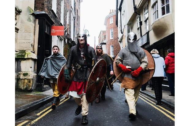 Vikings march down the road in York, home to the Jorvik Viking Centre