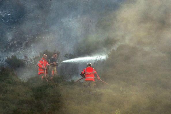 STALYBRIDGE, ENGLAND - JUNE 27: Fire officers continue to fight a large wildfire on the moors above Stalybridge, Greater Manchester on June 27, 2018 in Stalybridge, England.  (Photo by Anthony Devlin/Getty Images)