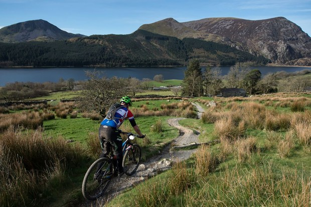 A cyclist takes part in the 'Snowdonia Mountain Bike Challenge' near Llanberis, north Wales on March 26, 2017. The Challenge is the only mountain bike event to incorporate a section of path up Mount Snowdon, the highest peak in Wales. Riders are able to choose between four route lengths from 22 kilometres to 75 kilometres featuring long steep climbs, fast grass tracks, technical single-tracks and forest roads.  / AFP PHOTO / Oli SCARFF        (Photo credit should read OLI SCARFF/AFP/Getty Images)